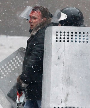 An injured man is escorted during clashes.