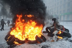 Protesters burn tyres.