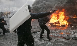 A protester points a handgun during a clash.