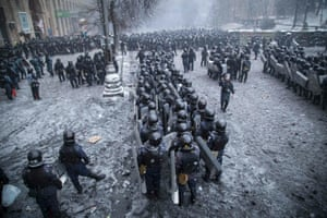Riot police and Interior Ministry members stand in formation during clashes with pro-European protesters in Kiev.