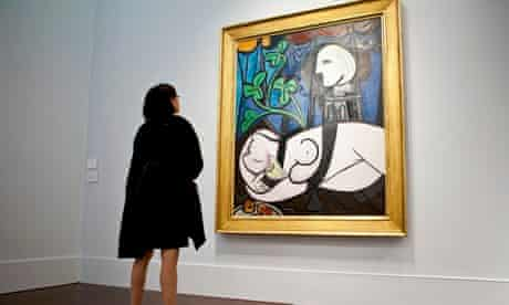 A woman looking at a Picasso painting