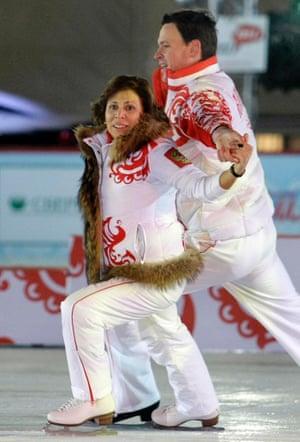 Soviet Olympic champion Irina Rodnina and Russian Olympic champion Maxim Marinin perform as they display the national team's new uniform for the 2010 Winter Olympics.