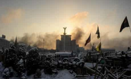 The sunrise above a barricade around of the anti-government protesters' camp on Independence Square. The violent protests have been raging in the Ukrainian capital since 19 January.