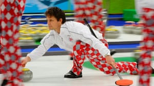 Thomas Ulsrud of Norway throws in a sea of fancy pants during the men's Gold Medal match with Canada.