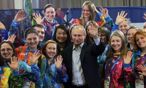 Vladimir Putin poses with Sochi Winter Olympics 2014 volunteers. It's not often that he's the most stylish person in a room.