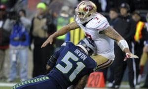 Seahawks linebacker Bruce Irvin tackles San Francisco 49ers quarterback Colin Kaepernick