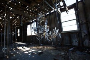 Rebuilding New Orleans: A broken chandelier inside a blighted home
