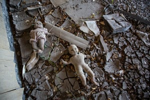 Rebuilding New Orleans: Dolls left in the mud