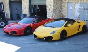 Two sports cars, involved in the Justin Bieber drag racing incident, sit in a Miami police compound.