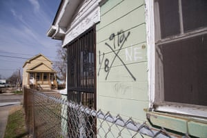Rebuilding New Orleans: A house in the Lower Ninth ward with an X code, spraypainted by search-and-