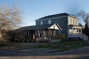 Rebuilding New Orleans: Skeleton of a shotgun house next to a brand new, two-storey home on Delery