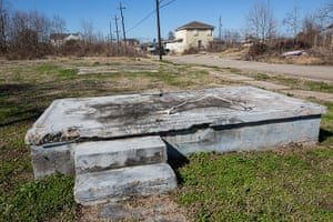 Rebuilding New Orleans: Foundation of a home left in the path of a broken levee in from of a new ho