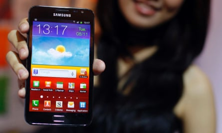 Woman holding Samsung Android smartphone