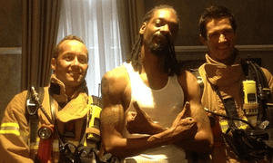 Snoop Dogg with Melbourne firefighters after smoke from his hotel room set off a fire alarm