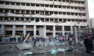 Emergency workers gather at the Egyptian police headquarters after the blast in central Cairo