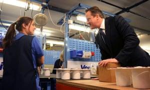 David Cameron talks to a worker at ventilation maker Vent-Axia