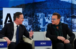 Britain's Prime Minister David Cameron and singer Bono (R) attend a session at the annual meeting of the World Economic Forum (WEF) in Davos January 24, 2014.
