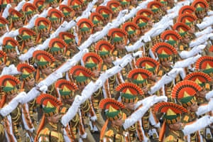Indian paramilitary servicemen march down Rajpath during the final full dress rehearsal for the Indian Republic Day parade in New Delhi