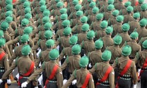 Indian soldiers march down Rajpath during the final full dress rehearsal for the Indian Republic Day parade in New Delhi.