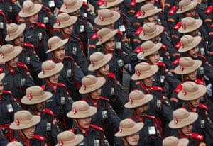 Indian Army soldiers march during the full dress rehearsal for the Republic Day parade in New Delhi.