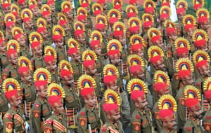 Indian border security force personnel take part in the full dress rehearsal of Indian Republic Day parade in New Delhi.