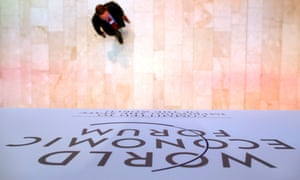 A participant makes his way to a session during the annual meeting of the World Economic Forum (WEF) in Davos January 24, 2014.