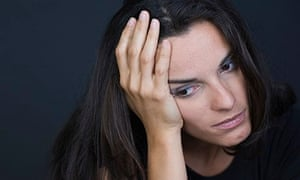 Young depressed woman on black background