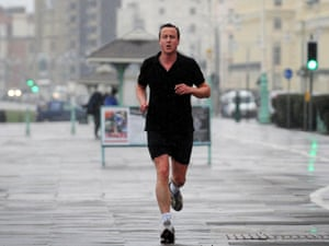 David Cameron takes a run along the sea front in Brighton