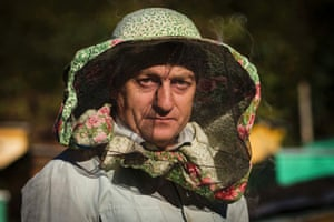 Circassian villager Muzarbek Teshu poses for a photograph as he attends to his bee hives in the village of Tkhagapsh in the Lazerevskoye district of Sochi. Teshu, who inherited a beekeeping business from his father and produces his own wine, lives mostly off the produce he makes. Historically, honey making has been one of the main trades the Circassian people have been know for, Teshu said. Tkhagapsh is one of the few remaining settlements in the Sochi region, that mainly consists of ethnic Circassians.