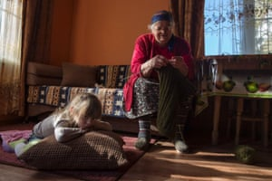 Circassian villager Ashirkhan Chachukh, 82, and her great-grand daughter Saira, 4, sit in the living room of their house in the village of Tkhagapsh in the Lazerevskoye district of Sochi.