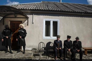 Local Circassian men wearing traditional clothes watch a welcome ceremony for diaspora Circassians at a tourist lodge in Golovinka, outside Sochi.