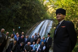 A delegation of diaspora Circassians pose for a family photograph at a waterfall in Bolshoy Kichmay, Greater Sochi.