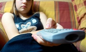 Girl watches TV