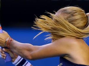 Hair today … Dominika Cibulkova powers back a return.