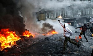 A protester throws a molotov cocktail during clashes with police in Kiev, Ukraine