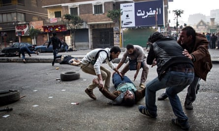 A mortally wounded supporter of ousted Mohamed Morsi during clashes with security forces in Cairo