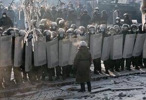 Ukraine: A woman talks to riot police