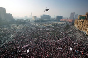 Cairo protest: An Egyptian army helicopter flies over the crowd