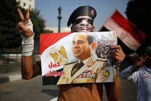 Cairo protest: a poster and a mask depicting Gen. Abdel-Fattah el-Sissi