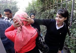 Cairo protest: Egyptian policewoman checks the veil of a visitor