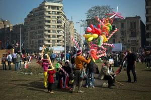 Cairo protest: An Egyptian street vendor sells balloons