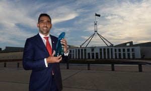 Australian of the Year 2014 Adam Goodes poses for photographs after receiving his award during a ceremony at Parliament House in Canberra, Saturday, Jan. 25, 2014.