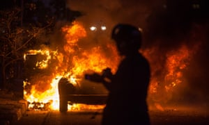 A car catches fire during demonstrations in Sao Paulo on Saturday against the staging of the upcoming 2014 World Cup Brazil.