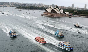 Ferries race past the opera house during the annual harbour ferry boat race during Australia Day celebrations in Sydney, Australia, Sunday, Jan. 26, 2014.
