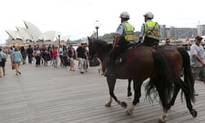 Police on horseback patrol Circular Quay during Australia Day celebrations in Sydney, Australia, Sunday, Jan. 26, 2014.