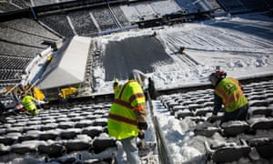 """Workers dig out MetLife Stadium before what's being called the first """"cold weather Super Bowl"""" by many, even though it's not. The Denver Broncos and Seattle Seahawks will face off in front of over 80,000 fans on Sunday."""
