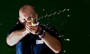 Police sergeant demonstrates a taser