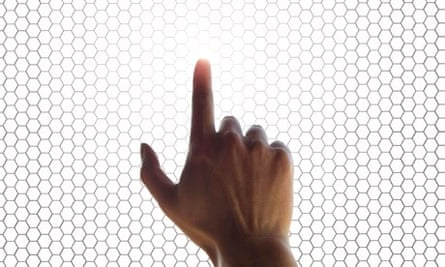 hand on a touchscreen grid