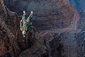 BASE jumping in Utah: A parachutist somersaults from the edge of the canyon