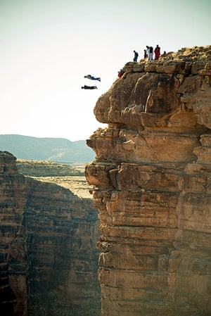 BASE jumping in Utah: Others watch as two parachutists plummet towards the ground